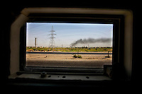 BAGHDAD, IRAQ - JULY 28: A war-ravaged Iraqi landscape as seen from the window of a passing American Army Humvee on July 28, 2007 in Baghdad, Iraq. The level of violence in Iraq is so high that the only way for foreigners and soldiers to observe civilian life is through the relative safety of an armored vehicle window. (Photo by Benjamin Lowy/Reportage by Getty Images)