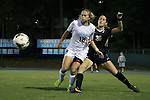 09 October 2014: North Carolina's Megan Buckingham (18) and Wake Forest's Sarah Medina (30). The University of North Carolina Tar Heels hosted the Wake Forest University Demon Deacons at Fetzer Field in Chapel Hill, NC in a 2014 NCAA Division I Women's Soccer match. UNC won the game 3-0.