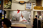 A butcher prepares meat for a customer at Maiwand Market, in Fremont, Ca., on Saturday, March 7, 2009.