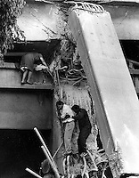 1989 Loma Prieta Earthquake, Oakland, California.<br />Survivors are helped down from the collapsed double decked Sypress freeway. (photo/Roy Williams-Oakland Tribune)