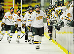 29 December 2010: University of Vermont Catamounts forward H.T. Lenz, a Freshman from Vienna, VA, celebrates a goal scored against the 2011 U.S. Men's National University Team in an exhibition game at Gutterson Fieldhouse in Burlington, Vermont. The Catamounts defeated the National team 7-1. Mandatory Credit: Ed Wolfstein Photo