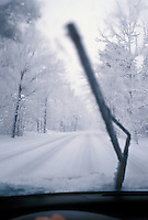 Winter driving conditions on a road in Marquette, Mich. as seen from the inside of a vehicle.