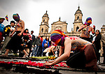 Women draw a symbol in the bolivar square while they take part in a march supporting prostitution in Bogota, Colombia. 25/02/2012.  Photo by Eduardo Munoz Alvarez / VIEWpress.