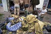 """Actors get undressed in front of the costume truck at the end of the day's filming of """"The Last Prince"""" television series at Hengdian World Studios near Hengdian July 23, 2015. Extras and actors with smaller roles often take care of their own costumes and play more than one character in this production about the war against Japan. Director Li Xiaoqiang said the series is about a Qing Dynasty prince, who joined the Chinese nationalist army after suffering family misfortune. """"After he learnt more about the Communist Party, the prince began to understand what real revolution and the anti-Japanese war meant, and turned to the Communist Party to fight Japan"""", the director added. According to local media, more than 10 new movies, 12 TV dramas, 20 documentaries and 183 war-themed stage performances will be released in China to coincide with the 70th anniversary of the end of World War Two. REUTERS/Damir SagoljPICTURE 26 OF 28 FOR WIDER IMAGE STORY """"BEHIND THE SCENES OF A CHINESE WAR DRAMA"""".SEARCH """"SAGOLJ STUDIO"""" FOR ALL PICTURES."""