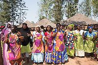 Africa, DRC, Democratic Republic of the Congo, South Kivu, Kamanyola. Women for Women project. WFW Kamanyola co-op and lifeskills training. Women dancing in greeting.