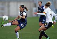USA's Christen Press fights for the ball with Germany's Babett Peter during their Algarve Women's Cup soccer match at Algarve stadium in Faro, March 13, 2013.  .