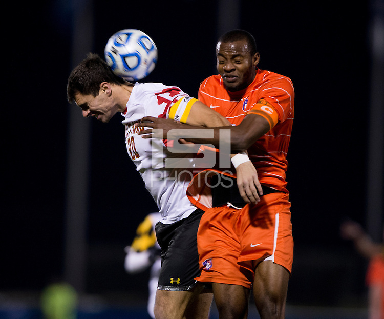 Jake Pace (20) of Maryland goes up for a header with Phanuel Kavita (18) of Clemson during the ACC tournament semifinals at the Maryland SoccerPlex in Boyds, MD.  Maryland defeated Clemson, 1-0, in overtime.