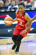 Washington, DC - July 22, 2016: Washington Mystics guard Ivory Latta (12) drives to the basket against Los Angeles Sparks guard Chelsea Gray (12) during their match up at the Verizon Center in Washington, DC. (Photo by Phil Peters/Media Images International)