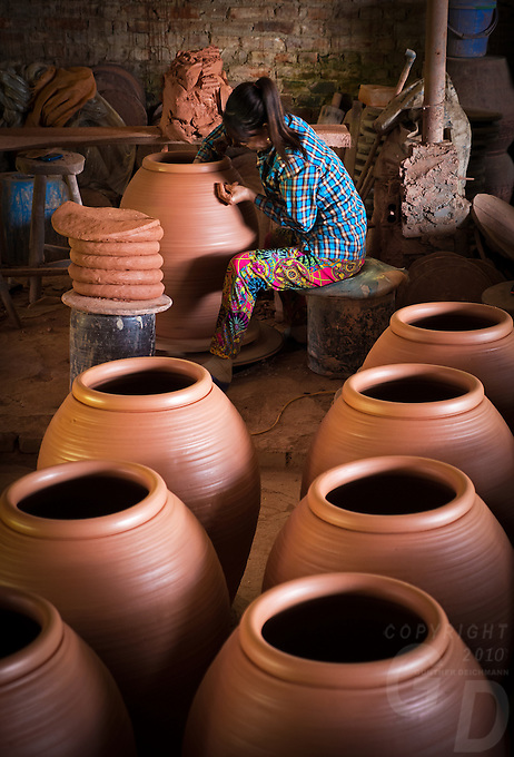 In this small traditional Pottery Village about 2 hours drive north of Hanoi people producing clay coffins, Urns, Pots and other stone ware. Vietnam