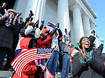 Photo by Phil Grout..Jubilation comes over Brigette Wright and her children and the crowd at the Lincoln Memorial the moment Barrack Obama is officially sworn in.as president.