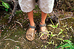 Child's muddy sandals after hiking the Pihea Trail into the Alaka'i Swamp, Koke'e State Park, Kauai, Hawaii