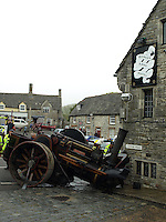 BNPS.co.uk (01202 558833).Pic: Nick Squirrel/BNPS.co.uk..***Please use full byline***..The operator of a vintage steam roller was forced to plough into a pub to avoid crushing a car that suddenly pulled out in front of him...The male driver was chugging downhill on the 10-ton roller when a motorist turned into the road in front of him without warning...He had no choice but to swerve out of the way to avoid driving into and over the vehicle but collided with the outside wall of the 16th century pub...Amazingly, because the listed building is made of robust Purbeck stone it suffered hardly any damage.