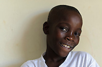 Young boy at an orphanage supported by EDV, Port-au-Prince, Haiti. EDV is committed to affecting permanent change in disaster-affected communities worldwide. Their role is to facilitate personal connections between volunteers and the survivors of disasters.  The charity is based on a proven model developed by several landmark organisations that have paved the way for citizens to become disaster volunteers. These landmark organisations have shown that supposedly ordinary people working together with the guidance of knowledgeable leaders can make an extraordinary difference in the lives of those affected by disaster..EDV believe that to provide meaningful relief and reconstruction assistance to disaster affected communities they have to do more than reconstruct buildings. They need to understand and address the factors that made a community vulnerable to the disaster in the first place. The charity's work is organised with these factors in mind so that they can affect change that far outlives their presence..EDV believes that survivor motivation is essential to the recovery of any disaster-affected community. Their operations will always be predicated on the idea that survivors may be traumatised, but they are not helpless. With this in mind, EDV encourages host communities to direct their own recovery. EDV believe that this empowerment is essential in helping survivors feel a renewed sense of control over their lives which will, in turn, help overcome the feelings of hopelessness that can follow a disaster and inhibit long term recovery. EDV also believe that social cohesion is of primary importance in any disaster-affected area. No amount of bricks or mortar will bring about sustainable improvement if communities fail to come together or are disrupted by relief efforts. Therefore, their operations will always aim to foster communication and cooperation within and between the communities they serve.