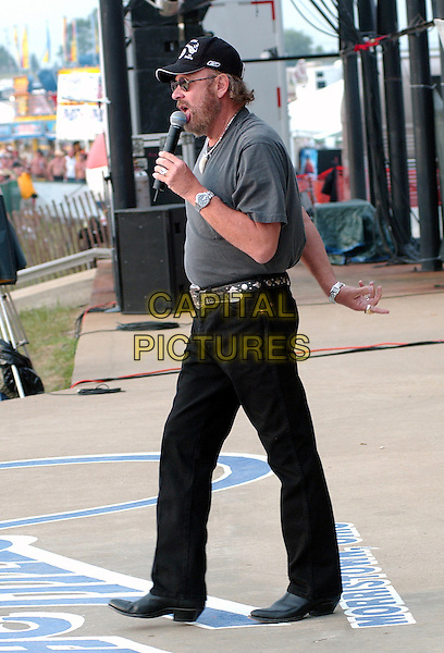 HANK WILLIAMS JR.Performs at Jamboree In The Hills.Morristown, 16th July 2005.country music singing microphone grey t-shirt sunglasses    .baseball hat full length full-length.www.capitalpictures.com.sales@capitalpictures.com.© Capital Pictures.