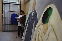 Mexico City, Mexico. May, 2006.  An inmate rehearses backstage for the prison's production of Romeo & Juliette at Santa Martha Acatitla, Mexico City's high security women's prison.