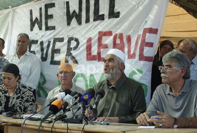 Sheikh Raed Salah, head of the Arab-Israeli Islamic Movement, speaks to press on July 13, 2009, at a newly-erected protest tent in the Israeli-annexed east Jerusalem neighborhood of Silwan, where Palestinian houses are threatened to be demolished by the city's municipality. If the municipality orders are carried out, 88 homes would be demolished, leaving 1,500 people homeless and constituting one of the largest forced evictions since Israel occupied and annexed mostly Arab east Jerusalem in the 1967 war.. Photo by Mahfouz Abu Turk