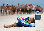 """Matthew Harrelson, a 2 year-old from Carrabelle, takes a break from his Memorial Day weekend at the White Trash Bash at Dog Island off the coast of Carrabelle Sunday May 27, 2007.  """"We came over yesterday and camped out"""" said his mother Niki Kennedy.(Photo by Mark Wallheiser/TallahasseeStock.com)  (Mark Wallheiser/TallahasseeStock.com)"""