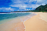 Blue Pacific water and white sand at Tunnels Beach, North Shore, Island of Kauai, Hawaii