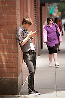 Hugh Dornbush (@hugh) checks his messages on his smart phone during the 140 Character conference in New York City, USA, 16 June 2009.