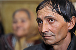 """THIS PHOTO IS AVAILABLE AS A PRINT OR FOR PERSONAL USE. CLICK ON """"ADD TO CART"""" TO SEE PRICING OPTIONS.   Todor Janosev is a member a Roma congregation of The United Methodist Church in Srbobran, Serbia. Here he listens to the sermon during a worship service. Behind him is Mira Janosev."""