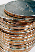 FIFTY CENT COINS<br /> Close Up Of Stack Of Coins With &quot;Clad&quot; Composition<br /> Showing layer of copper