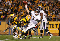PITTSBURGH, PA - NOVEMBER 06:  Joe Flacco #5 of the Baltimore Ravens throws the ball just as he is being hit by James Harrison #92  of the Pittsburgh Steelers during the game on November 6, 2011 at Heinz Field in Pittsburgh, Pennsylvania.  (Photo by Jared Wickerham/Getty Images)