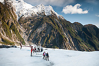 Glacier guide and group of helihikers on Franz Josef Glacier, Westland National Park, West Coast, World Heritage Area, New Zealand