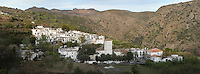 Mecina, Taha Valley, Alpujarra, Andalucia, Southern Spain, against a mountainous background. Moorish influence is seen in the distinctive cubic architecture of the Sierra Nevada's Alpujarra region, reminiscent of Berber architecture in Morocco's Atlas Mountains. Photograph by Manuel Cohen.