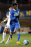 12 December 2014: UCLA's Larry Ndjock (GER) (in blue) and Providence's Phil Towler (ENG) (8). The University of California Los Angeles Bruins played the Providence College Friars at WakeMed Stadium in Cary, North Carolina in a 2014 NCAA Division I Men's College Cup semifinal match.