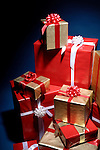 Huge pile of Christmas gift boxes illuminated in darkness isolated on dark blue background