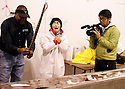 A cameraman films as Japanese TV host Ayako Imoto, center, reacts to Sweetwater Jaycee Danny Williams gutting a rattlesnake during the 54th annual Rattlesnake Roundup at Nolan County Coliseum in Sweetwater, Texas on Friday, March 9, 2012.