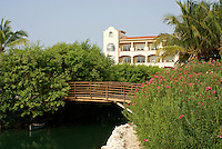 Canoe under bridge at Hacienda Tres Rios, an eco-luxury resort on the Riviera Maya, Quintana Roo, Mexico.