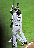 New York Yankees right fielder Nick Swisher (33) celebrates after hitting a 2 run home run in the seventh inning against the Baltimore Orioles at Oriole Park at Camden Yards in Baltimore, MD on Friday, August 26, 2011.  The Orioles won the game 12 - 5..Credit: Ron Sachs / CNP.(RESTRICTION: NO New York or New Jersey Newspapers or newspapers within a 75 mile radius of New York City)