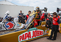 Apr 22, 2017; Baytown, TX, USA; NHRA top fuel driver Leah Pritchett with crew members as she climbs into her dragster alongside teammate Antron Brown during qualifying for the Springnationals at Royal Purple Raceway. Mandatory Credit: Mark J. Rebilas-USA TODAY Sports