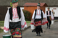 Men wearing traditional dresses of the Matyo people participate the Easter watering celebration in Mezokovesd (about 130 km East of capital city Budapest), Hungary on April 13, 2017. ATTILA VOLGYI