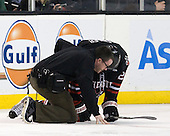 Steve Clark (Northeastern - Trainer), Luke Eibler (Northeastern - 20) - The Boston College Eagles defeated the Northeastern University Huskies 5-4 in their Hockey East Semi-Final on Friday, March 18, 2011, at TD Garden in Boston, Massachusetts.