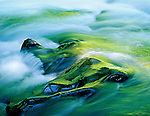 Sol Duc River rushing over rocks reflecting spring colors on riverbank, Olympic National Park, Washington State