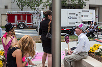 Anti-corporate activists sit outside a welcome event for Democratic National Convention delegates from North Carolina, South Carolina, Virginia, Georgia and Tennessee at the NASCAR Hall of Fame on Sunday, September 2, 2012 in Charlotte, NC.