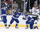 Scott Mathis (Air Force - 23), Scott Kozlak (Air Force - 8), Sean Bertsch (Air Force - 15), Colin Dueck (Yale - 21) - The Yale University Bulldogs defeated the Air Force Academy Falcons 2-1 (OT) in their East Regional Semi-Final matchup on Friday, March 25, 2011, at Webster Bank Arena at Harbor Yard in Bridgeport, Connecticut.
