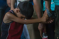 Illegal migrant boy stands in queue to buy tickets for their train to travel to Germany at the main railway station Keleti in Budapest, Hungary on August 31, 2015. ATTILA VOLGYI