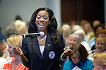 A woman speaks during a workshop at the United Methodist Women Assembly in the Kentucky International Convention Center in Louisville, Kentucky, on April 25, 2014.