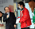 March 16, 2012, Tokyo, Japan - President Masayoshi Son, left, of Japans Softbank, congratulates the first customer on getting the New iPad as the Apples retailer kicks off the release of its third-generation tablet computer at its flagship store in Tokyos Ginza shopping district on Friday, March 16, 2012. Japanese Apple manias lined up well before the opening of the store to grab the new Apple product. Japan was one of the initial 10 countries where the brand new iPad hit shelves as earely as 8:00 in the morning. (Photo by Natsuki Sakai/AFLO) AYF -mis-