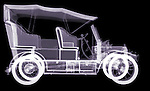 X-ray image of an antique car (purple on black) by Jim Wehtje, specialist in x-ray art and design images.
