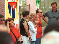 "HAVANA-JUNE 15: Dalia Soto del Valle, (C) Castro´s wife and his son Antonio Castro (R), listens the speech of Fidel on the reformations to the Cuban Constitution that intends that the Political, Economic and Social System of the system one-party Cuban is ""untouchable"", today the  15 of June 2002.  The Government from Cuba responds of this form to the speech of the President of U.S, George W. Bush, the past May 20, where he requests to Fidel Castro that carries out changes in his political system. Credit: Jorge Rey/MediaPunch"
