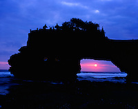 Natural Sea Arch at Tanah Lot, Bali Coast, Island of Bali, Pacific Ocean at Bali Strait, Indonesia