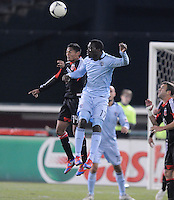 Sporting Kansas City forward C.J. Sapong (17) head the ball against D.C. United mifielder Andy Najar (14)Sporting Kansas City defeated D.C. United  1-0 at RFK Stadium, Saturday March 10, 2012.