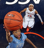 CHARLOTTESVILLE, VA- JANUARY 5: Brittany Rountree #11 of the North Carolina Tar Heels shoots in front of Ariana Moorer #15 of the Virginia Cavaliers during the game on January 5, 2012 at the John Paul Jones arena in Charlottesville, Virginia. North Carolina defeated Virginia 78-73. (Photo by Andrew Shurtleff/Getty Images) *** Local Caption *** Ariana Moorer;Brittany Rountree