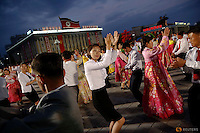 People participate in a mass dance in the capital's main ceremonial square, a day after the ruling Workers' Party of Korea party wrapped up its first congress in 36 years, in Pyongyang, North Korea May 10, 2016.  REUTERS/Damir Sagolj