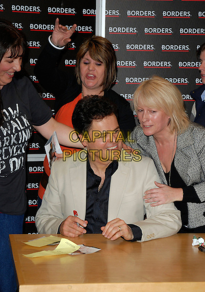 DONNY OSMOND.Signs copies of his new album in Borders Book Shop, Oxford Street, London, England, 9th March 2007..half length black shirt beige jacket fans.CAP/CAN.©Can Nguyen/Capital Pictures