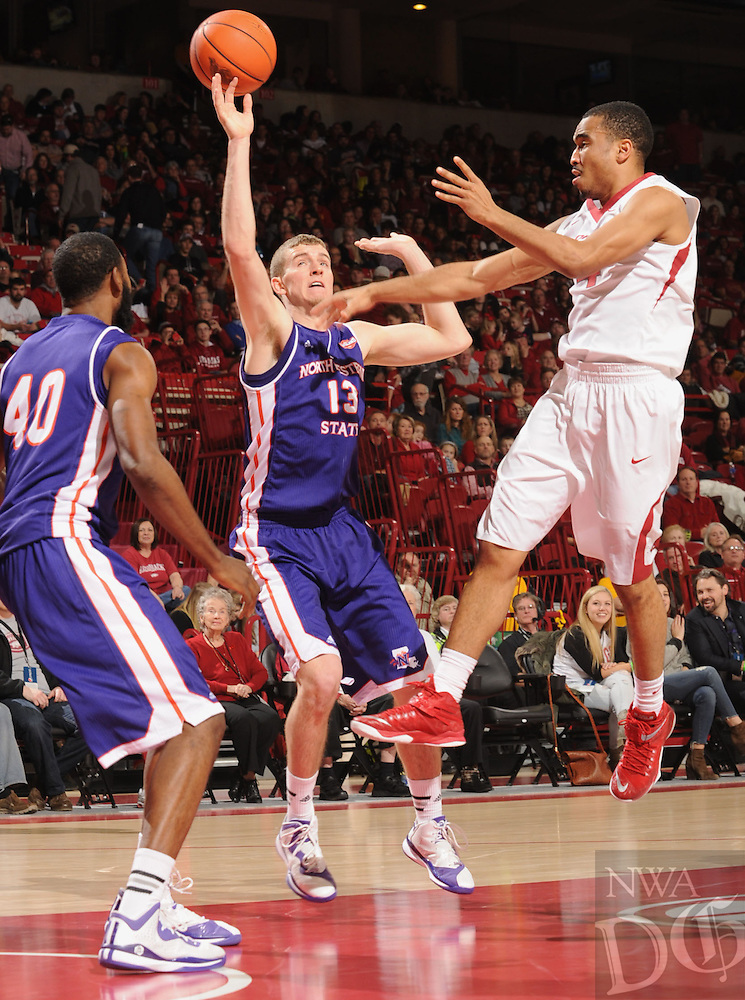 NWA Media/ANDY SHUPE - Arkansas' Jabril Durham, right, has his pass deflected by Northwestern State's Matt Killian (13) during the second half of the Razorbacks' 100-92 win Sunday, Dec. 28, 2014, in Bud Walton Arena in Fayetteville.